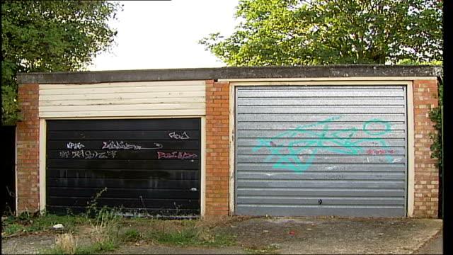enfield council offering reward to catch graffiti artists graffiti on pavement graffiti on buildings graffiti tag on poster advertising antigraffiti... - tag 2 stock-videos und b-roll-filmmaterial