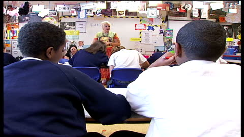 enfield school improves results after outsourcing management; back view anonymous shots of school pupils during lesson soft focus view school kids... - soft focus stock videos & royalty-free footage