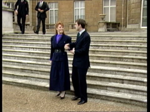 Engagement of Prince Andrew and Sarah Ferguson is announced ITN London Buckingham Palace Sarah Andrew walking down Palace steps towards pose at...
