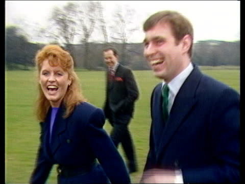Engagement of Prince Andrew and Sarah Ferguson is announced ITN London Buckingham Palace Sarah Ferguson Prince Andrew in Palace grounds walking away...