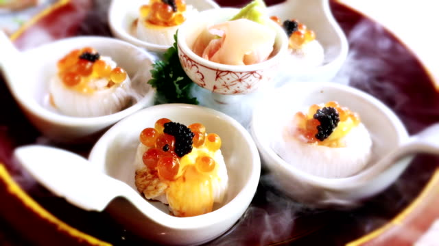 engawa sushi canape on spoon at a japanese restaurant. - dining stock videos & royalty-free footage
