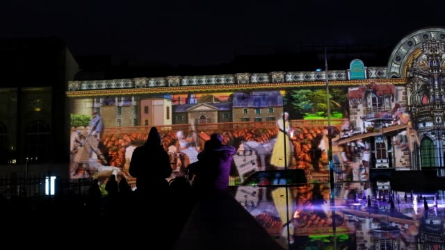 vidéos et rushes de enghienlesbains france the monumental projectionsthe three main buildings in the city are home to colorful frescoes… and echoing the news a legend... - bruno levesque