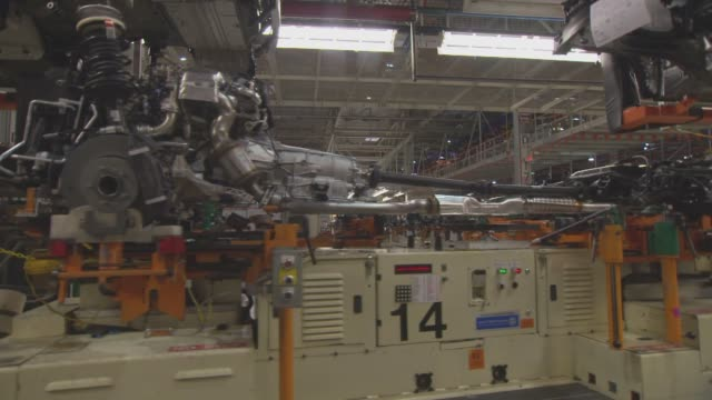 engine and axle frames move on an assembly line at the general motors design center factory floor in warren michigan on november 20th 2013 - general motors stock videos & royalty-free footage