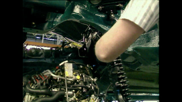 engine being fitted into a car from below; 1989 - 1989 stock videos & royalty-free footage