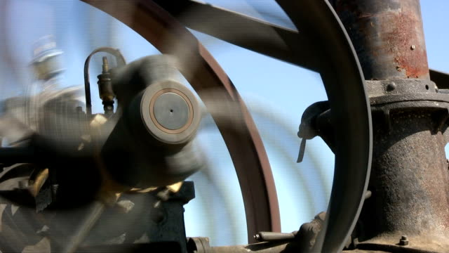 Engine iron wheel moving in front of blue sky