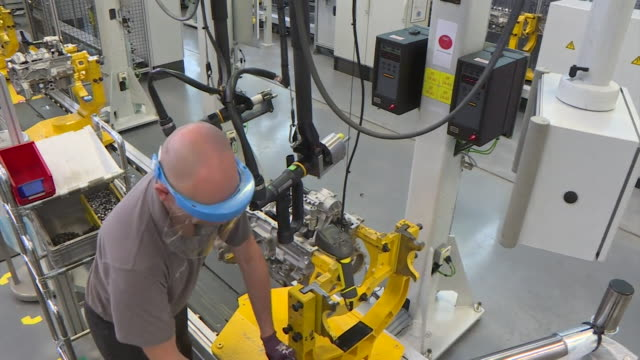 engine manufacturing production line in jaguar landrover factory in solihull as it reopens after coronavirus lockdown, staff wear ppe masks - plant stock videos & royalty-free footage
