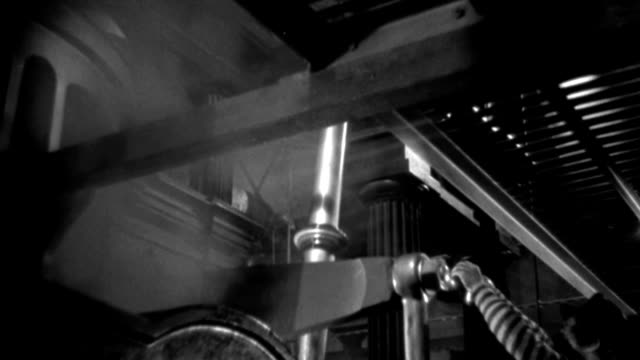 int - engine room first steamship - ship - machinery in motion - oiler in - b&w.  (neg only) - machine part stock videos & royalty-free footage
