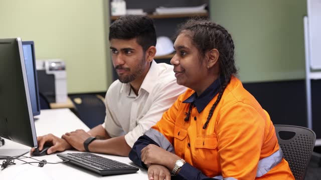 engineer and apprentice working together in office - employment issues stock videos & royalty-free footage