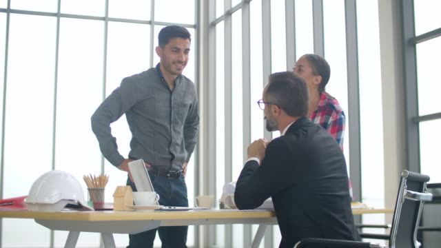 engineer and architect people meeting in a office - critic stock videos & royalty-free footage