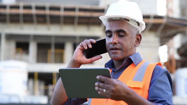 engineer at construction site, using digital tablet - looking stock videos & royalty-free footage
