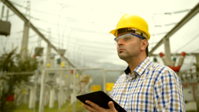 engineer at power station using tablet - power station stock videos and b-roll footage