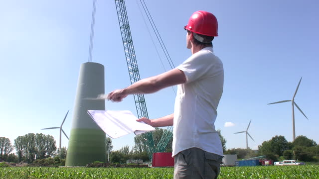 engineer building wind turbine - directing stock videos and b-roll footage