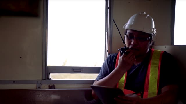 engineer checking engine of train - transport conductor stock videos & royalty-free footage