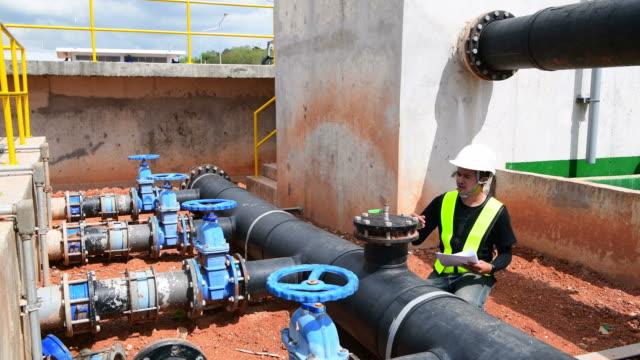 engineer checking water pump in factory - boiler stock videos & royalty-free footage