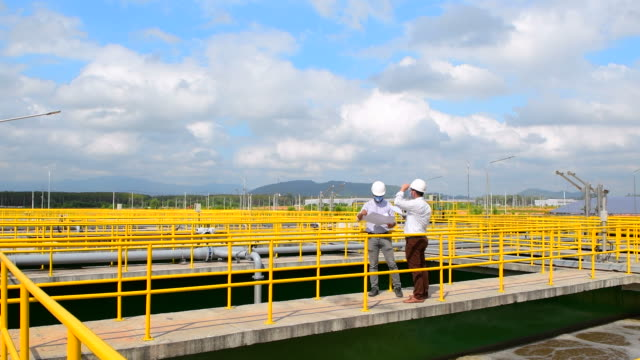 engineer checking water treatment plant - quality control stock videos & royalty-free footage