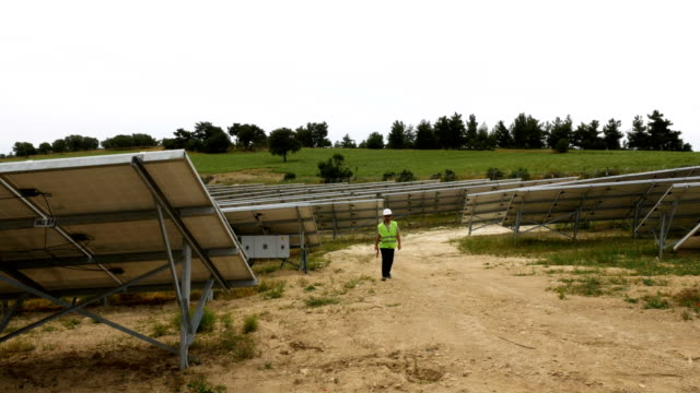 Engineer checks the solar panels in the field ,Environmentally friendly electricity production , Sustainable Renewable Energy