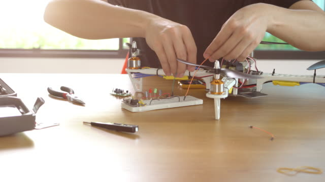 engineer developing electronic drone - model kit stock videos and b-roll footage