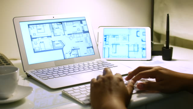 engineer drawing home plan on laptop with digital tablet, 4k(uhd) - architect stock videos and b-roll footage