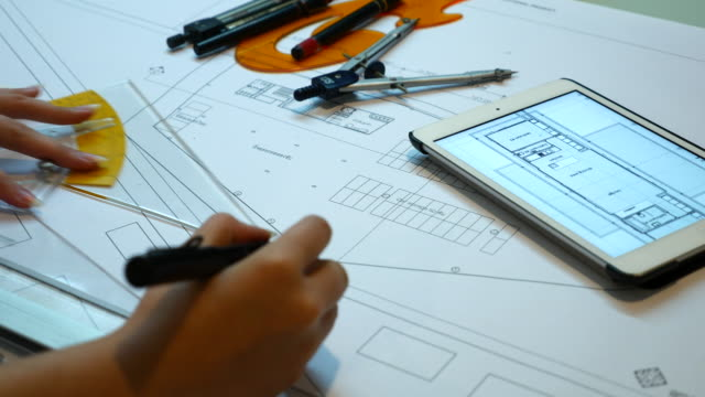 engineer drawing on blue print with digital tablet, 4k(uhd) - pair of compasses stock videos & royalty-free footage