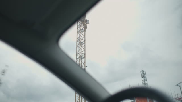 Engineer Driving to Construction Site