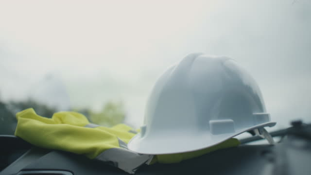 engineer driving to construction site - occupational safety and health stock videos and b-roll footage