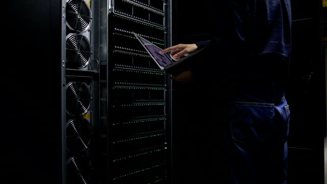 engineer examining with topological graph in server room - examining stock videos & royalty-free footage
