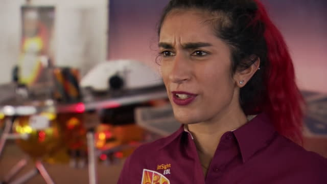 stockvideo's en b-roll-footage met nasa engineer farah alibay talking about how excited she is that the insight spacecraft made a successful landing on mars - ruimte exploratie
