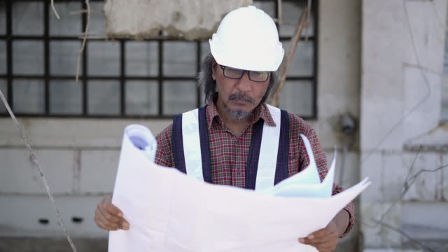 engineer foreman looking blueprint(plan) at work place. - chief leader stock videos & royalty-free footage
