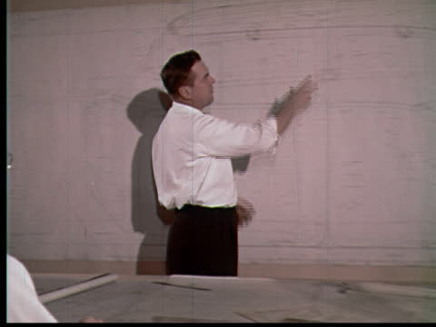 vídeos y material grabado en eventos de stock de 1955 ms zo pan engineer going over large car blueprint with three other men / usa - cianotipo plano