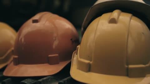engineer helmet in construction site. - work helmet stock videos & royalty-free footage