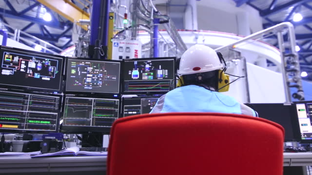 engineer in control room - industria petrolifera video stock e b–roll