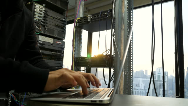 it engineer in network room - cloud computing stock videos & royalty-free footage