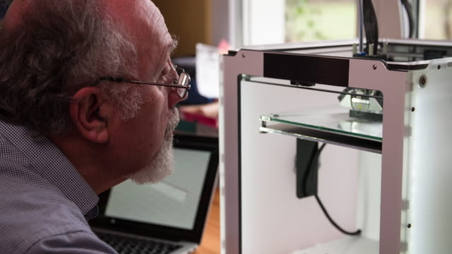 Engineer inspecting 3d Printer