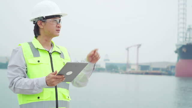 engineer inspects the industrial harbor. - health and safety stock videos & royalty-free footage