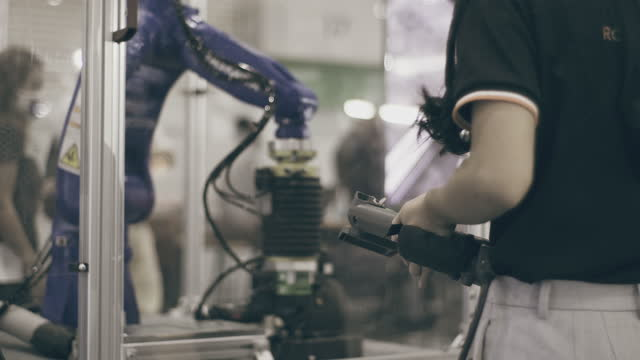 engineer is controlling a futuristic robotic arm - engineer stock videos & royalty-free footage