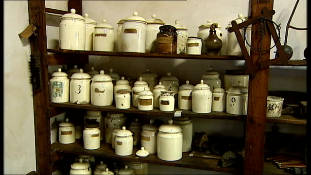 engineer james watt's workshop exhibition in science museum; mechanical copying machine invented by watt ceramic jars stacked on shelving close up of... - industrial revolution stock videos & royalty-free footage