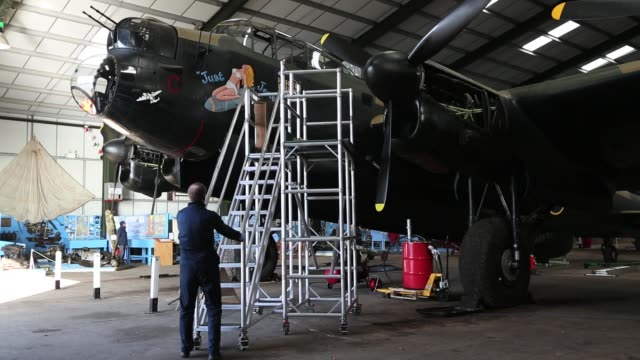 engineer keith breachley works on the lancaster bomber 'just jane' with the aim of getting it airworthy at lincolnshire aviation heritage centre on... - bomber plane stock videos and b-roll footage