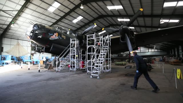 engineer keith breachley works on the lancaster bomber 'just jane' with the aim of getting it airworthy at lincolnshire aviation heritage centre on... - lancaster bomber stock videos & royalty-free footage