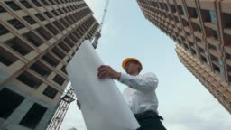 Engineer looking floor plans at a construction site