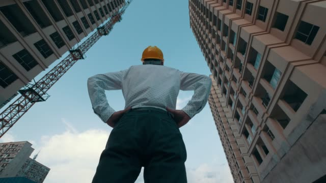 engineer looking up the building he designed proudly - tall high stock videos & royalty-free footage