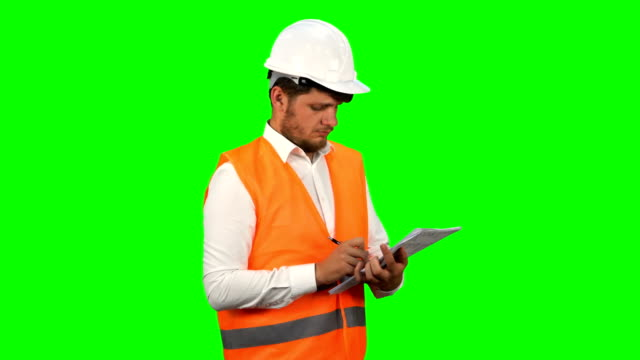 engineer man taking notes - employment issues stock videos & royalty-free footage