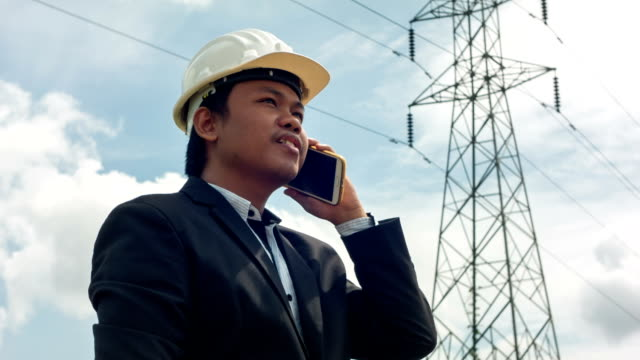 HD : Engineer manager working under electric tower.