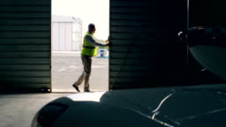 Engineer opening hangar gate 4k