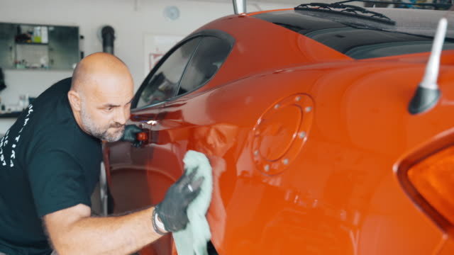 engineer polishing car with car polisher at auto repair shop - car stock videos & royalty-free footage