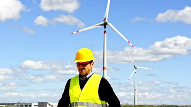engineer portrait with the wind turbine - local produce stock videos & royalty-free footage