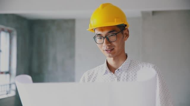 engineer reading blueprints indoor - examining stock videos & royalty-free footage