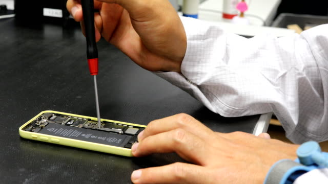 engineer repairing smart phone with screwdriver - repairing stock videos & royalty-free footage