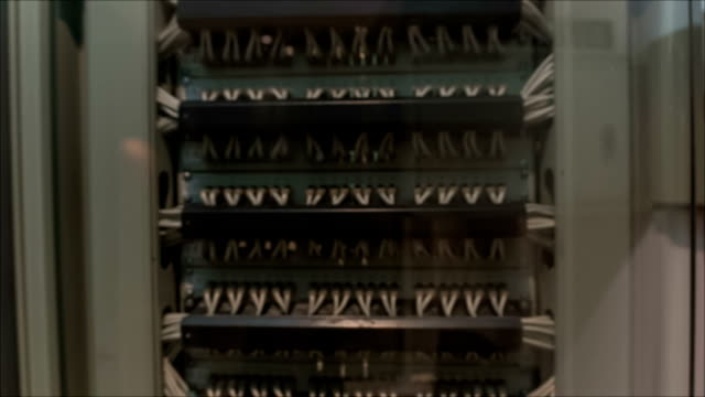 it engineer standing near datacenter servers - telephone switchboard stock videos and b-roll footage