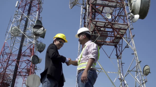 engineer team at communication tower - telecommunications equipment stock videos & royalty-free footage