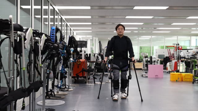 engineer testing exoskeletal legs to walk at hyundai motor group research center in uiwang kyonggido province south korea on friday january 31 2020 - exoskeleton stock videos & royalty-free footage